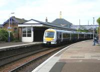 A partially re-liveried ScotRail DMU calls at Burntisland station in May 2005 with a service for Edinburgh.<br><br>[John Furnevel&nbsp;26/05/2005]