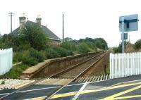 The former Kinloss Station on 12 September 2004. View is east from the level crossing looking towards Elgin. Kinloss station closed to passengers in May 1965. [See image 3657]<br><br>[John Furnevel&nbsp;12/09/2004]