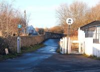 Former level crossing at Duddingston on <i>The Innocent Railway</i> in 2004. View west across Duddingston Road towards Holyrood Park and the tunnel to St Leonards. [See image 17619]<br><br>[John Furnevel&nbsp;10/11/2004]