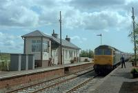 A 47 hauled train train heads slowly north through Barrhill as tablets are exchanged.<br><br>[Andy Kirkham&nbsp;//]