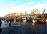 The early morning train for Inverness off the Far North Line  crossing the river at Conon Bridge on 23 November 2003 on the way to its next stop at Muir of Ord.<br><br>[John Furnevel&nbsp;23/11/2003]