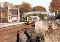 An Aberdeen - Inverness train calls at Nairn on a bright Autumn day in October 2005. The line in the foreground served the former goods yard [see image 40189].<br><br>[John Furnevel&nbsp;31/10/2005]