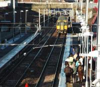 A service from Dalmuir enters a busy Larkhall station on its first day of public service.<br><br>[Ewan Crawford&nbsp;12/12/2005]