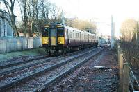 A Larkhall service from Dalmuir enters the passing loop to the south of Ferniegair.<br><br>[Ewan Crawford&nbsp;12/12/2005]