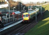 A southbound service enters the wholly new station at Merryton.<br><br>[Ewan Crawford&nbsp;12/12/2005]