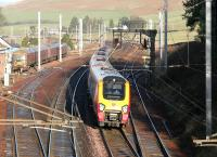 An up Virgin Voyager runs south past a Royal Mail class 325 stabled in the sidings at Abington on 24 December 2005.<br><br>[John Furnevel&nbsp;24/12/2005]