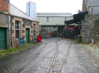 Track still in situ within the old March Street Mills, Peebles. Looking south in December 2005 with George Street behind the camera. The Peebles line closed in 1962.<br><br>[John Furnevel&nbsp;02/12/2005]