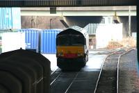 Locomotive and freight stand in the shadows in one of the sheds at WHM, Grangemouth in January 2006. The windows of Fouldubs Junction signal box can just be seen between the M9 motorway supports.<br><br>[John Furnevel&nbsp;24/01/2006]
