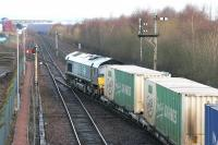 Looking towards Grangemouth Docks from Fouldubs Junction in January 2006 as DRS 66406 eases a container train forward from the W H Malcolm depot.<br><br>[John Furnevel&nbsp;24/01/2006]