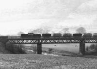 Looking north towards the Ochil Hills west of Tillicoultry on a misty morning in the autumn of 1971. A Clayton Type 1 locomotive is crossing Glenfoot Viaduct over the River Devon at the head of a Dollar - Alloa coal train [see image 3628].<br><br>[John Furnevel&nbsp;07/10/1971]