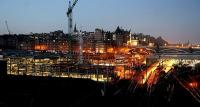 Early morning at Waverley in January 2006 with the lights of the new Edinburgh Council HQ construction site taking up most of the foreground of the picture.<br><br>[John Furnevel&nbsp;03/01/2006]