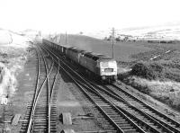 The Rootes/Chrysler company train, hauled by a pair of Brush Type 4s, photographed on the southern approach to New Cumnock heading for Linwood in 1973.<br><br>[John Furnevel&nbsp;21/06/1973]