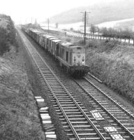 EE Type 1 8098 with a northbound freight running parallel with the A76 at Mennock on the GSWR main line south of Sanquhar in October 1970.<br><br>[John Furnevel&nbsp;26/10/1970]