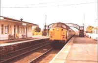 Class 37 arrives at Dingwall with a Wick/Thurso train in August 1982.<br><br>[John Gray&nbsp;//]