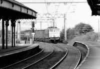 Looking north west from Peniston towards Manchester in September 1978 as a class 76 approaches the station with a trans-Pennine freight off the Woodhead route.<br><br>[John Furnevel&nbsp;12/09/1978]