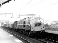 NBL 6130 takes a rake of mineral wagons west through Drumry towards Dumbarton in September 1971. The train is thought to be destined for Shipbreaking Industries at Faslane, where the empty wagons will be loaded with scrap.<br><br>[John Furnevel&nbsp;08/09/1971]