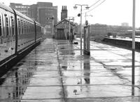 A North London Line service to Richmond about to depart from a rainsoaked Broad Street in August 1984. An inbound train is approaching centre right.<br><br>[John Furnevel&nbsp;11/08/1984]