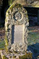 The memorial stone to the 30+ workers killed during the construction of Talla reservoir showing the <i>crossed pick & shovel</i>. Tweedsmuir churchyard 2005. For the full inscription [see image 6066].<br><br>[John Furnevel&nbsp;30/11/2005]