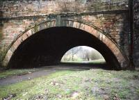 Here the line passed under the Luggie Aquaduct of the Forth and Clyde Canal and over the Luggie Water. The site was prone to flooding. This location has been tidied up since the photograph and the area beyond the bridge crossed by a main road.<br><br>[Ewan Crawford&nbsp;//]