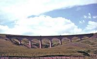 The gracefully curved Rispin Cleugh Viaduct near Leadhills on the Wanlockhead branch, built in 1891 by Sir Robert McAlpine & Co. The eight arch viaduct was of concrete construction clad with terracotta bricks to improve its appearance. It was demolished using explosives in December 1991. Some of the terracotta bricks were later used to clad the signal box at Leadhills station. [See image 11099]     <br><br>[John Robin&nbsp;//]