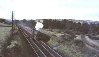Black 5 45105 approaching Beattock station with a southbound train of empty stock on 31 July 1965. Traces of the Moffat branch survive on the right.<br><br>[John Robin&nbsp;31/07/1965]