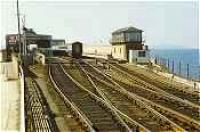 Stranraer Harbour in the 1980s. Rolling stock for a train to London rests in the station.<br><br>[Ewan Crawford&nbsp;//]