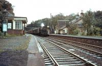 Platform view south at Abington on 26 September 1964 as Black 5 44672 runs through the station with a down freight.<br><br>[John Robin&nbsp;26/09/1964]