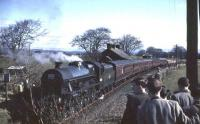 Jubilee 45588 <I>Kashmir</I> makes a photostop at Shieldhill, midway between Lockerbie and Dumfries, on 15 April 1963 with <I>Scottish Rambler No 2</I>. Passenger services had been withdrawn from the branch in 1952 and the line closed completely in 1966.<br><br>[John Robin&nbsp;15/04/1963]