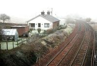 A pair of former surfacemens' cottages near the site of Auldgirth station (behind the camera) looking south through the mist towards Dumfries in January 2006.<br><br>[John Furnevel&nbsp;31/01/2006]