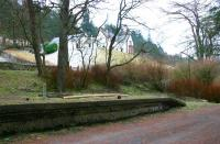 Southern end of the platform at Victoria Lodge in February 2006, with the branch to the top of the dam continuing its climb along the line of the wall centre left.<br><br>[John Furnevel&nbsp;01/02/2006]