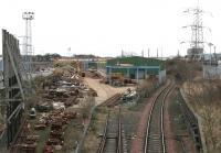 VAE Baileyfield Switch & Crossing Works, Portobello, looking along the branch from South Leith in February 2006. Running across the centre of the picture beyond the main shed is a class 66 heading south along the ECML with the morning Powderhall - Oxwellmains <I>Binliner</I> containers.<br><br>[John Furnevel&nbsp;07/02/2006]