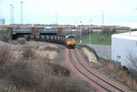 A coal train for Cockenzie leaves Leith Docks via South Leith yard and emerges from the bridge under Seafield Road in February 2006.<br><br>[John Furnevel&nbsp;/02/2006]