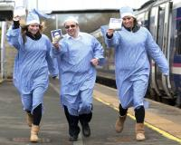 Dannine Stenhouse, Willie Cowan and Kerry-Ann Quinn armed with information on the Caledonian Sleeper at Inverkeithing on 9 March.<br><br>[ScotRail&nbsp;09/03/2012]