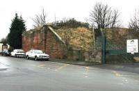 Looking south in December 2004 at the remaining abutment of the bridge across Seafield Street which carried the E&D line on its way up from Meadows Junction and yard (off picture to the left) towards Seafield Junction. The stairs provide access to the trackbed, which is now part of a walkway. [See image 6697] <br><br>[John Furnevel&nbsp;10/12/2004]
