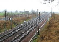 View south at Quintinshill in February 2006, showing the PW compound and access point on the east side of the line.<br><br>[John Furnevel&nbsp;09/02/2006]