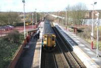 An Edinburgh Waverley - Glasgow Central via Shotts train calls at Carfin in February 2006. View west towards Holytown Junction from the B7066 road bridge.<br><br>[John Furnevel&nbsp;13/02/2006]