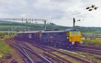 The Royal Train passing Craigendoran Junction behind 87028 <i>Lord President</i>.<br><br>[John Robin&nbsp;09/07/1981]