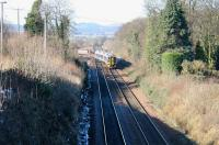 With traces of snow still visible, a train comes off the Bathgate branch at Newbridge Junction on 12 March 2006 with a service to Newcraighall.<br><br>[John Furnevel&nbsp;12/03/2006]