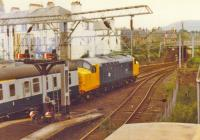 Spotless Class 37 pulls the Royal Train out of Helensburgh Central.<br><br>[John Robin&nbsp;09/07/1981]