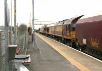 A train of loaded coal hoppers southbound through Auchinleck station on a chilly 13 March 2006. The train is double headed by a pair of EWS class 66 locomotives, with 66177 nearest the camera.<br><br>[John Furnevel&nbsp;13/03/2006]