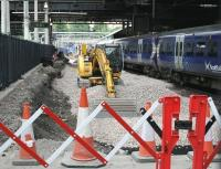 Work well underway on extending platform 12 at Waverley, seen here on 13 July 2017 from the position previously occupied by the buffer stops. (Photographed through a gap in the safety barrier). Demolition of the platform buildings directly behind the camera position is due to commence shortly. [See image 59986]<br><br>[John Furnevel&nbsp;13/07/2017]