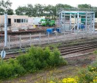 Work in progress in the area around the train washing plant at the new Millerhill EMU depot. View east across the freight lines on 16 July 2017, with the new depot located beyond the fence.<br><br>[John Furnevel&nbsp;16/07/2017]