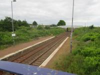 View west from the old footbridge at Breich to the new roadbridge. A ramp runs up from the westbound platform to the bridge and formerly another ran from the eastbound, now overgrown.<br><br>[John Yellowlees 26/06/2017]