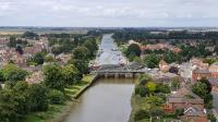 The 1215hrs Skegness to Nottingham service crosses the River Witham as it arrives in Boston on 14th July 2017. This view looks North West along the river from the tower of St Botolph's church (The Boston Stump)<br> <br><br>[David Prescott&nbsp;14/07/2017]