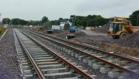 The new station site is progressing well, platforms are nearly complete, the footbridge is being erected and track laid. This view looks east, with the signal box in the distance.<br><br>[Alan Cormack&nbsp;07/07/2017]