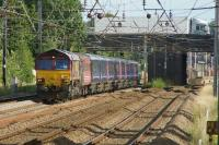 DBC 66054 heads to Kilmarnock with First Great Western coaches from Plymouth on 25 July 2015. Under the road bridge on the right is Euxton Balshaw Lane station.<br><br>[John McIntyre&nbsp;25/07/2015]