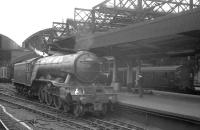 Platform scene at the east end of Newcastle Central in the summer of 1962. In the foreground is Gresley A3 Pacific no 60111 <I>Enterprise</I>, while in the background a Tyneside DC electric unit is preparing to depart for South Shields.<br><br>[K A Gray&nbsp;23/06/1962]