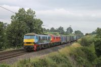 Colourful 90024, and DBS Red 90019, double head a Mossend to Daventry liner train towards Bay Horse on 19th July 2017. <br><br>[Mark Bartlett 19/07/2017]