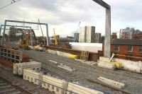 The first track has now appeared on the new Ordsall Chord, seen here on 27 July 2017 from a train travelling between Castlefield and Ordsall Junctions. The new track is connected up to this line but at the moment only goes as far as the RRV before the bridge.<br><br>[John McIntyre&nbsp;27/07/2017]