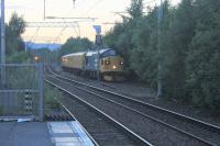 After touring West Scotland with the Network Rail train on the evening of 12th July 2017, 37025 <I>Inverness TMD</I> is seen running through the goods loop at Coatbridge Central as it takes the train to Carlisle. <br> <br><br>[Alastair McLellan&nbsp;12/07/2017]